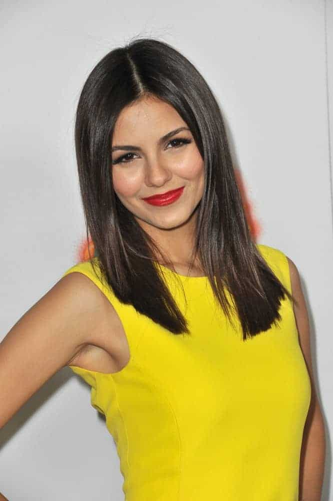 """Victoria Justice was at the Los Angeles premiere of her new movie """"Fun Size"""" at the Paramount Theatre, Hollywood on October 25, 2012. She was stunning in her yellow dress and medium-length straight raven hairstyle with layers."""
