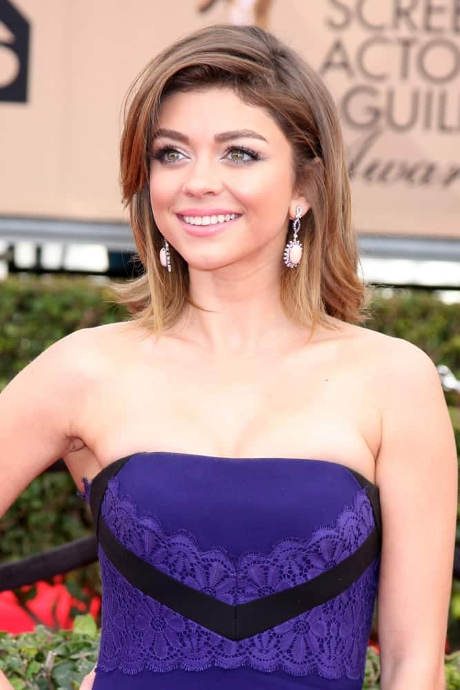Sarah Hyland showed off instant glamour with her shaggy deep side-part hairstyle as she attends the 22nd Screen Actors Guild Awards on January 30, 2016.