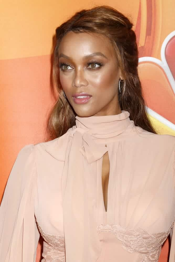 Tyra Banks styled her brunette hair into a half-up 'do at the NBC TCA Press Day Summer 2017 on August 2, 2017.