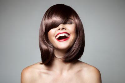 Woman with medium-length hair and bangs