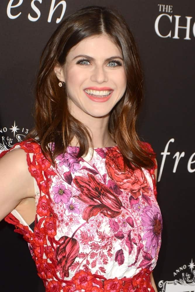 Alexandra Daddario looks soft and feminine with this smooth loose straight hair with middle parting at the Los Angeles premiere of 'The Choice' on February 1, 2016.
