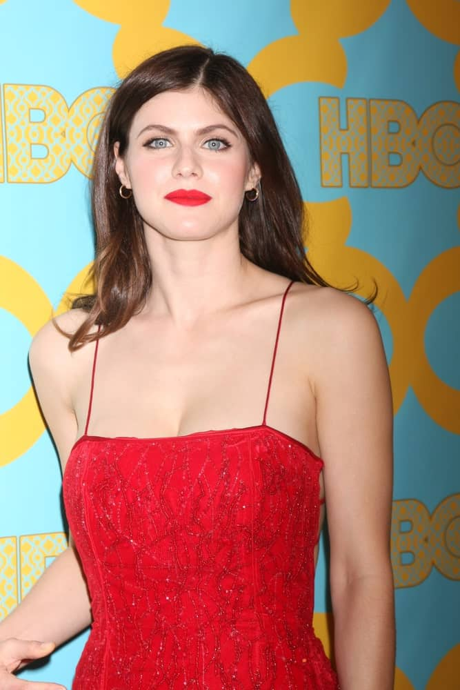 Alexandra Daddario wore her hair loose with slender waves as she attends the NBC Post Golden Globes Party on January 11, 2015.