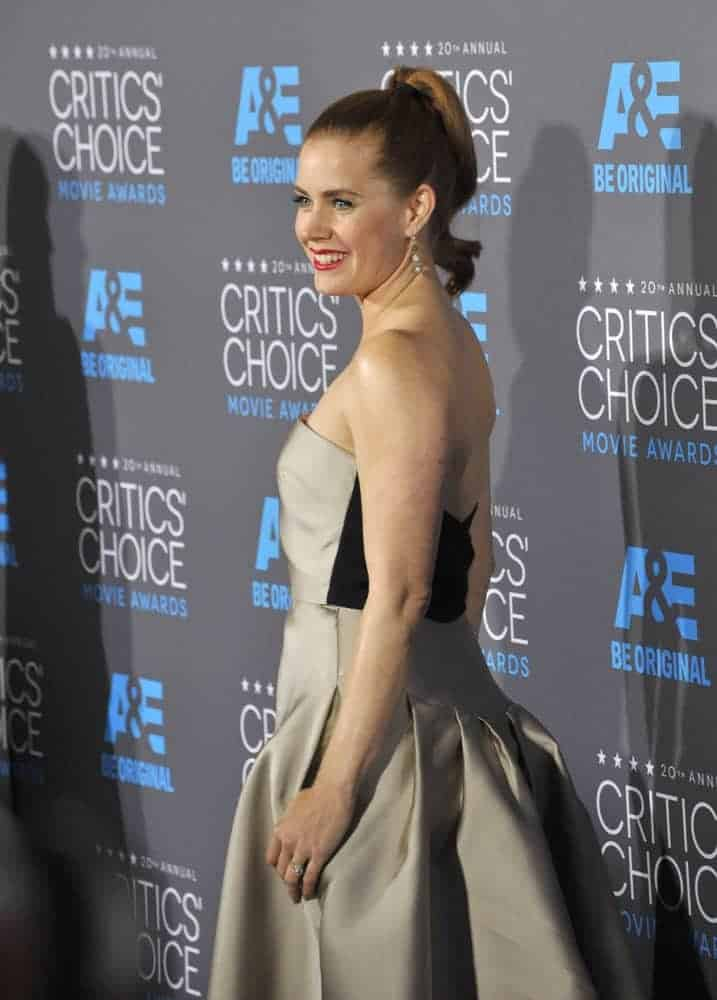 On January 15, 2015, Amy Adams attended the 20th Annual Critics' Choice Awards at the Hollywood Palladium. She wore a strapless dress with her slick ponytail hairstyle.