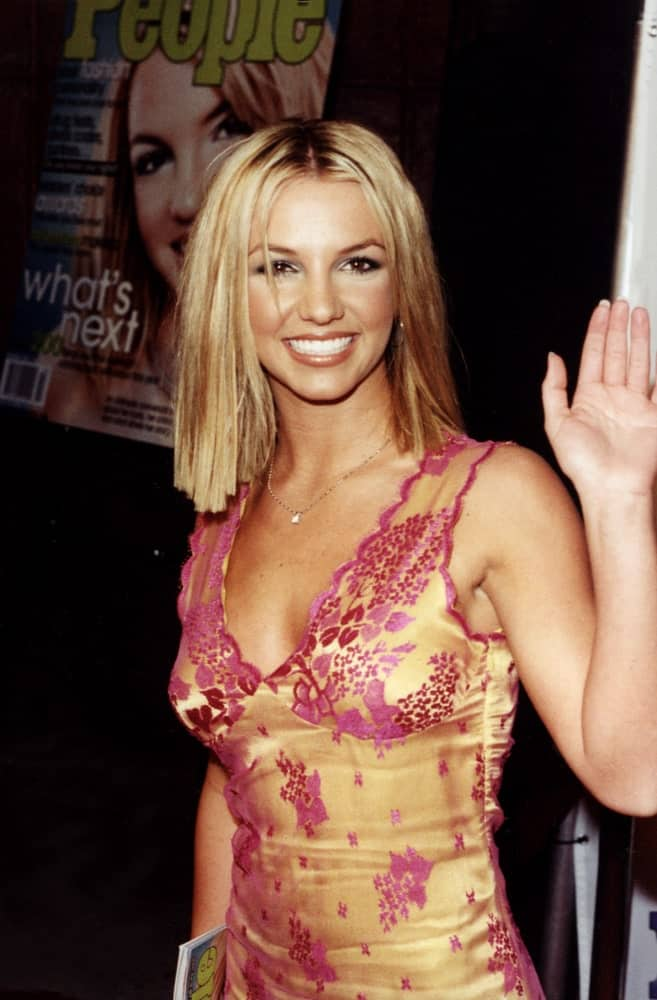 Britney Spears was seen with short center-parted hair at Los Angeles California in September 2000. She completed the look with a nice printed dress and a necklace.