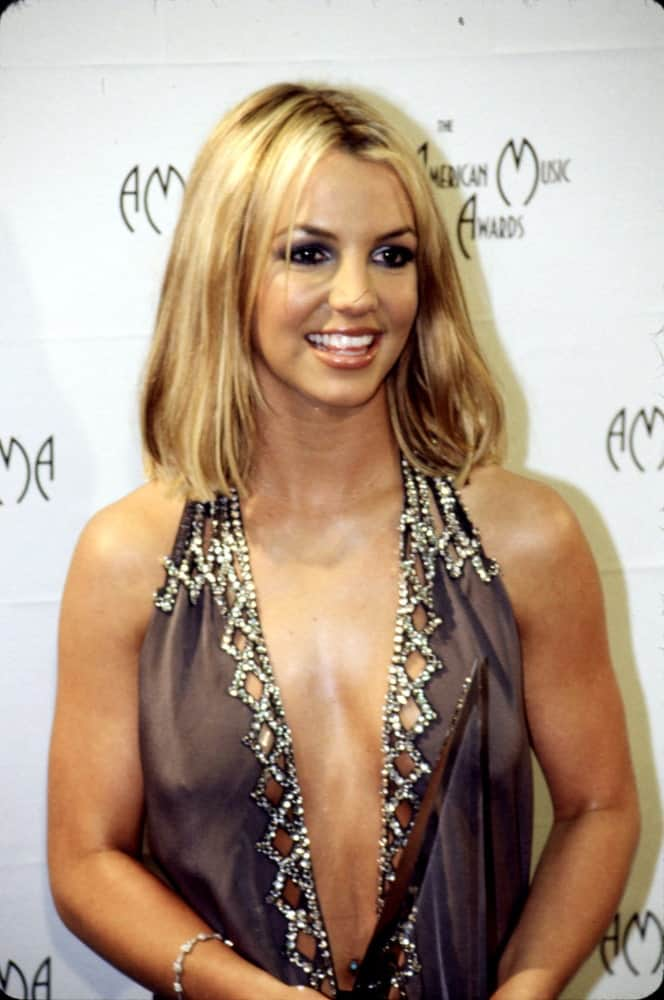 Singer Britney Spears looked ravishing in an enticing outfit paired with her straight shoulder-length hair. This was taken at the American Music Awards, Circa January 2000.