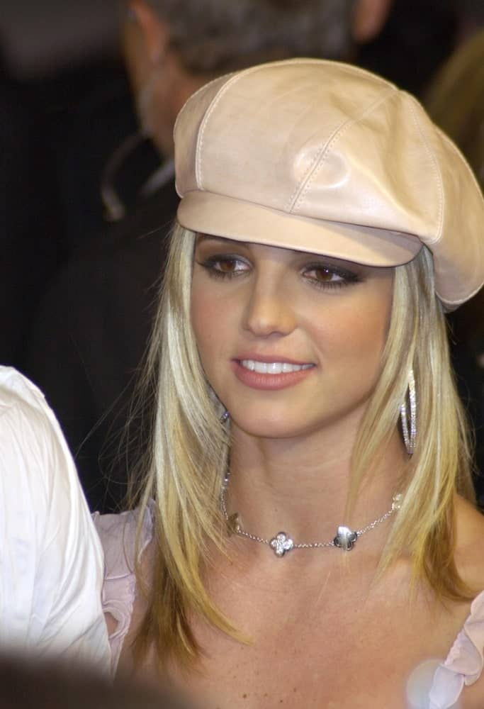 Pop star Britney Spears matches her medium length layered hair with a cute beret hat at the world premiere of her new movie Crossroads on February 11, 2002.