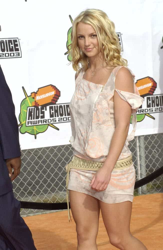 Teen Britney had blonde mid-length hair styled with defined curls during Nickelodeon's 16th Annual Kids' Choice Awards on April 12, 2003.