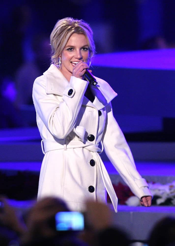 Britney Spears performing at the Debut of L.A. Live's 'Light of Angels' on December 4, 2008 sporting a loose upstyle incorporated with hoop earrings.