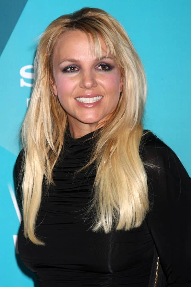 Britney Spears arrived for the X-Factor Season Two Finalist Party at SLS Hotel on November 5, 2012 with loose layered hair incorporated with short side bangs.