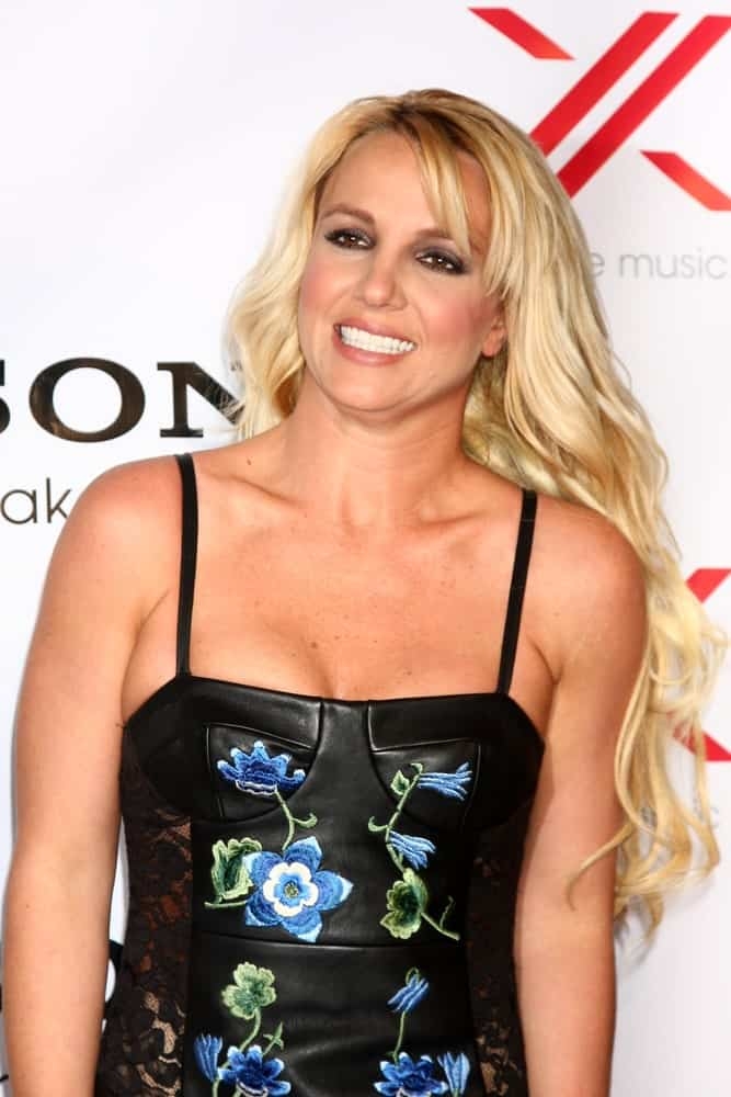 The singer wore a floral bodice dress along with long wavy blonde hair and some side bangs during the X Factor 2012 Final Four Party at Rodeo Drive on December 6, 2012.