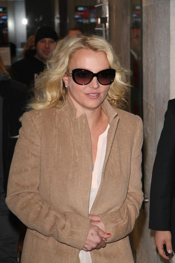 Britney Spears was seen leaving the BBC radio one studios on Oct 16, 2013 in London with tousled curly hair and black shades.