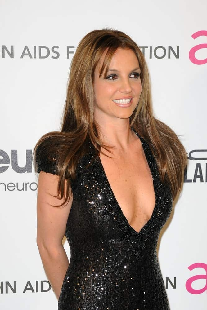 Britney Spears exhibited a sultry look featuring her long brunette hair with a few side bangs paired with a stunning deep V neck dress. This was worn at the Elton John Aids Foundation 21st Academy Awards Viewing Party last February 24, 2013.