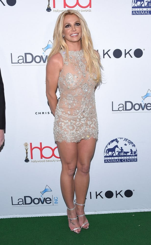 Britney Spears styled her long blonde hair with loose waves and a middle parting at the Hollywood Beauty Awards 2018 held on February 25th.