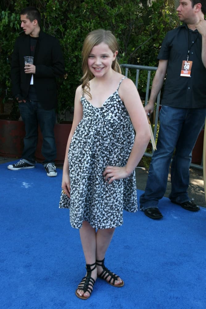 A young Chloe Grace Moretz was at the Teen Choice Awards 2008 at the Universal Ampitheater at Universal Studios in Los Angeles, CA August 3, 2008. She wore a lovely dress with her long sandy blonde hair in a ponytail with long side-swept bangs.