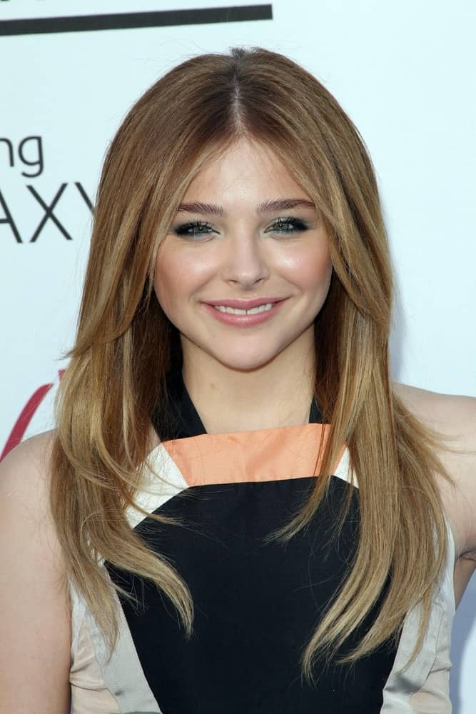 Chloe Grace Moretz was at the 2013 Billboard Music Awards held at the MGM Grand, Las Vegas, NV on May 19, 2013. She was lovely in her colorful dress and long layered brunette hairstyle that has long side bangs.