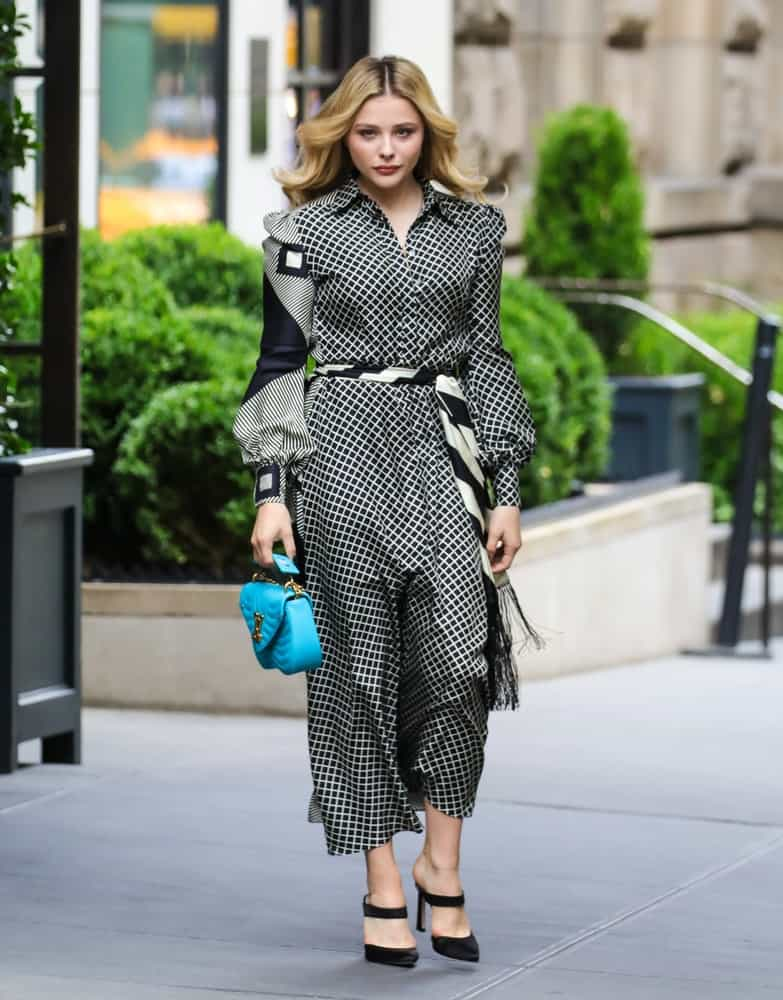 Chloe Grace Moretz was seen on August 2, 2018 walking the streets of New York City. She was seen wearing a lovely sundress, a blue purse and a loose tousled blonde hairstyle with waves and layers.