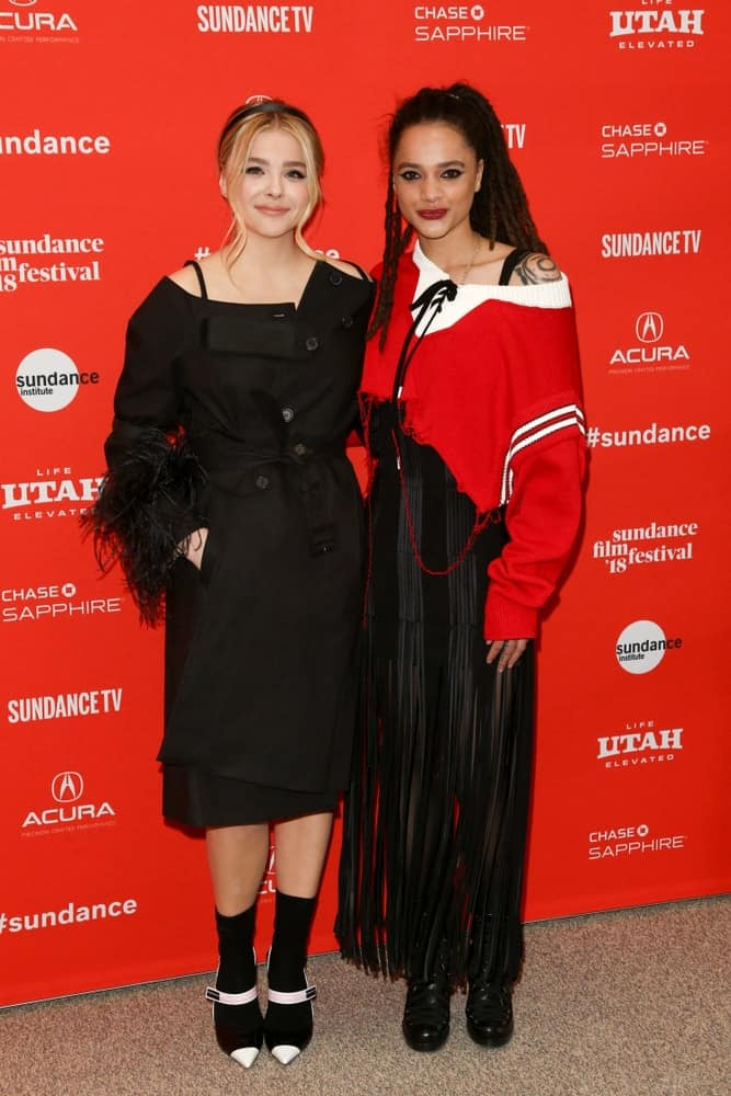 Chloe Grace Moretz and Sasha Lane attended 'The Miseducation of Cameron Post' premiere at 2018 Sundance Film Festival at Eccles Theater on January 22, 2018 in Park City, Utah. Moretz was wearing an all-black outfit that she paired with her messy highlighted bun hairstyle with loose side bangs.