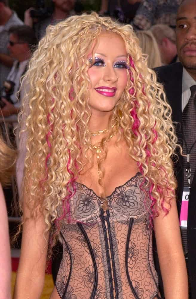 Christina Aguilera showcased a bold hairstyle with these curls and braids combination accentuated with magenta streaks during the MTV Movie Awards held on June 2, 2001.