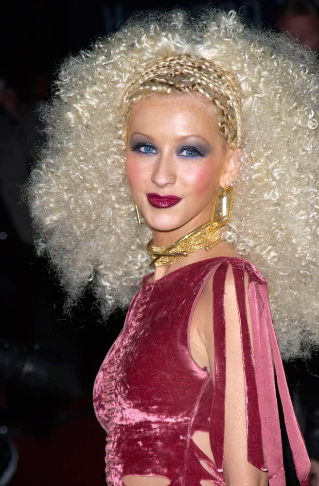 Christina Aguilera is a head-turner in braids and teased curls during the 2001 Blockbuster Awards on April 10, 2001.