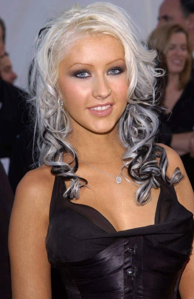 Christina Aguilera matched her two-toned curls with smokey eyes during the 30th Annual American Music Awards on January 13, 2003.