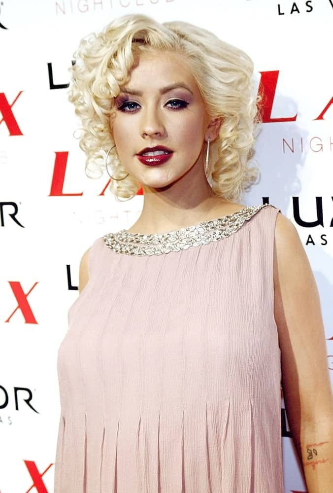 Christina Aguilera opted for an interesting look with her curls styled in a sleek finger wave plus some layers during the LAX Nightclub Party last September 8, 2007.