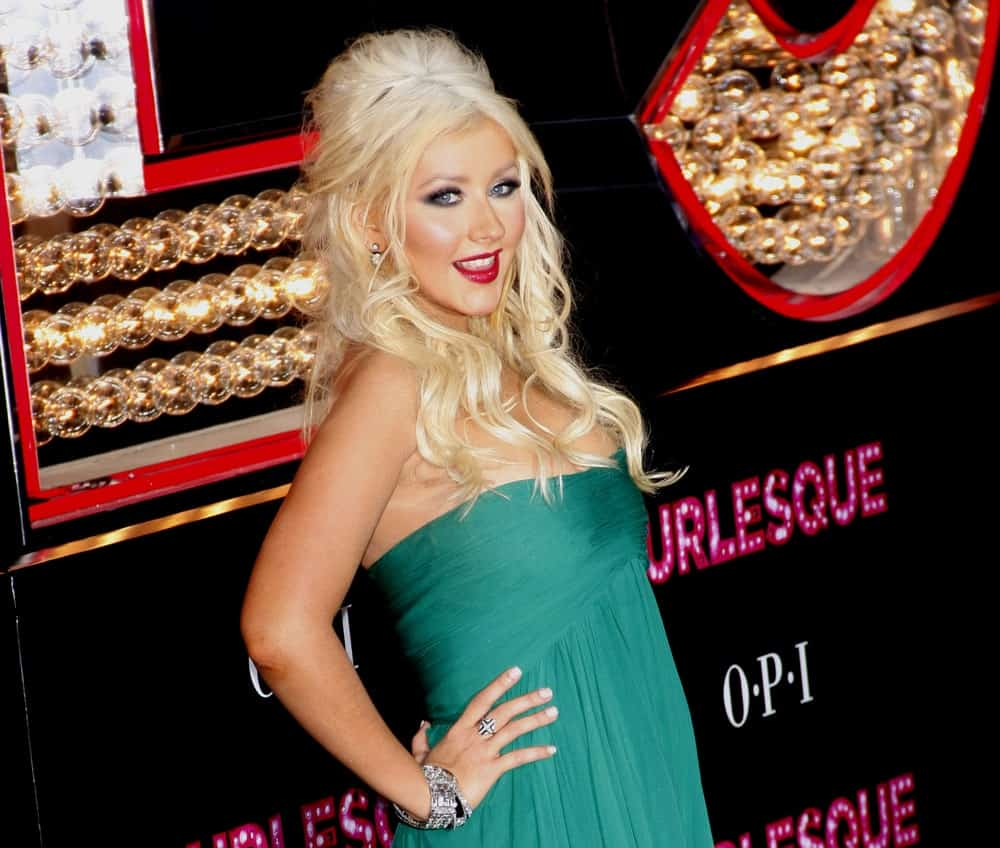 Christina Aguilera gathered her blonde waves into a half up bouffant during the Los Angeles premiere of