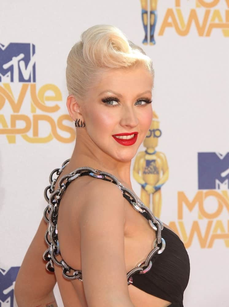 Christina Aguilera added a twist to her short pixie by styling it with a classic french roll in front during the 2010 MTV Movie Awards on June 06, 2011.