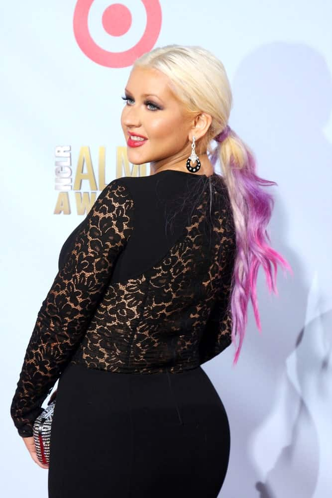 Christina Aguilera pulled back her purple and pink highlighted hair into a low ponytail during the 2012 ALMA Awards on September 16, 2012.