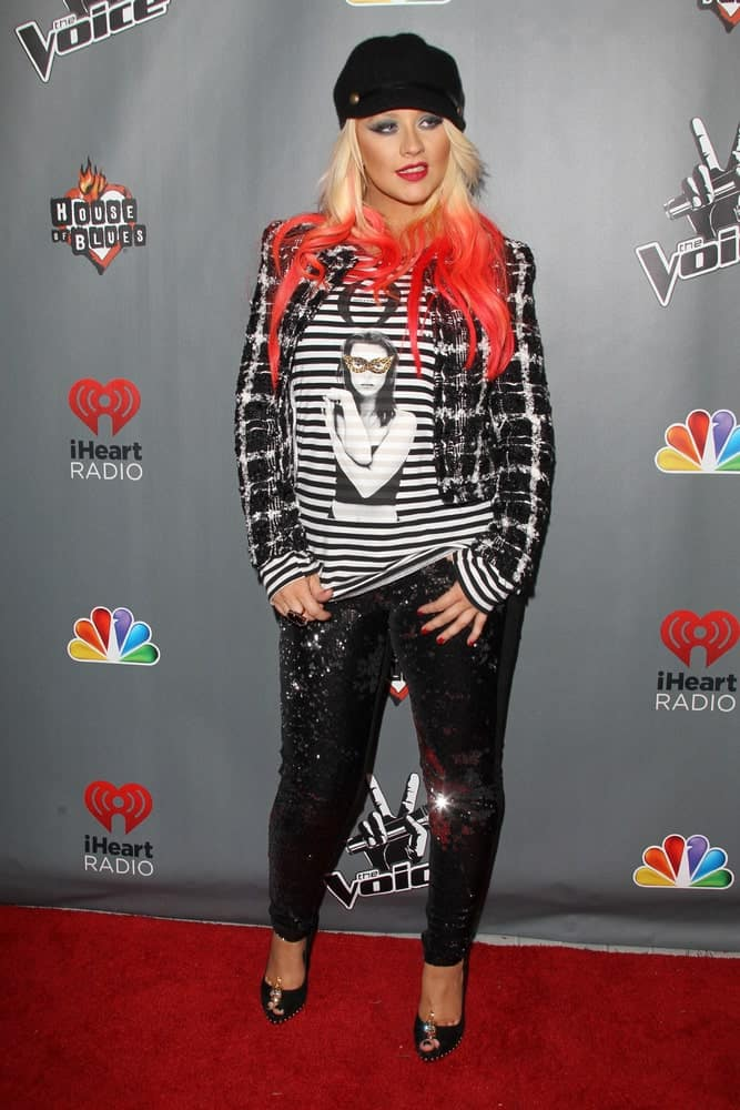 "Christina Aguilera is on fire with this red-streaked hairstyle at the ""The Voice"" Season 3 Top 12 Event held on November 8, 2012."