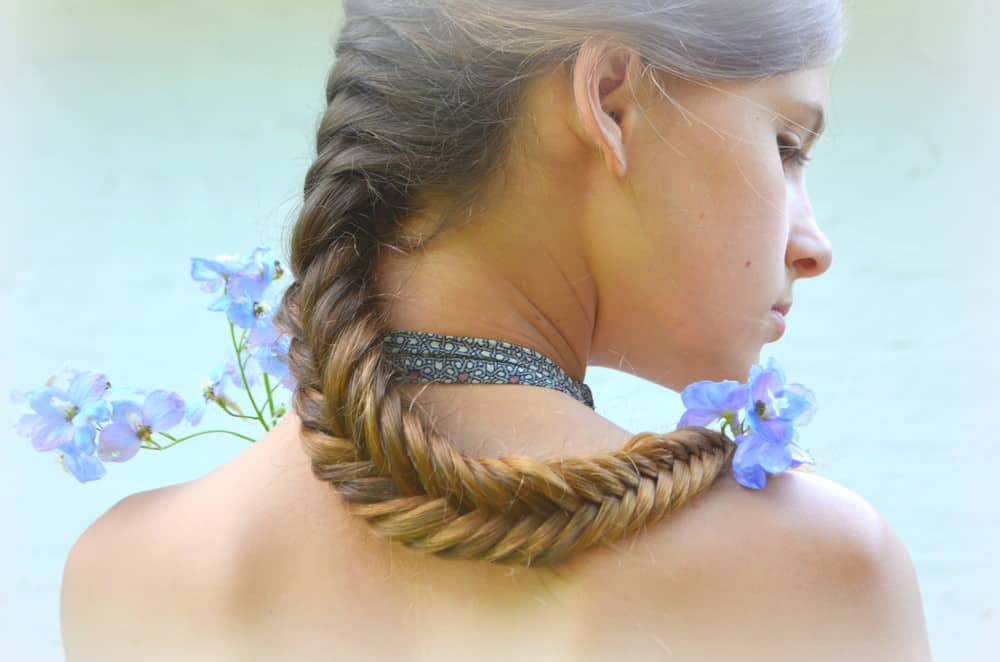 Woman with fishtail braided hair.