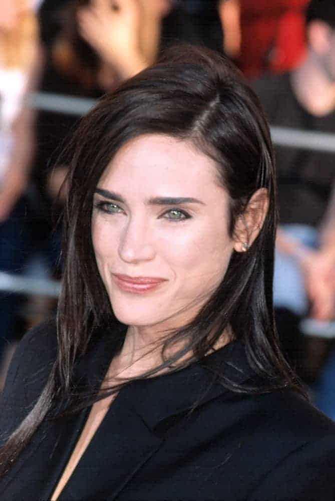 Jennifer Connelly attended the 8th Annual SAG Awards in Los Angels, CA on March 10, 2002. She was seen in a black dress with her shoulder-length layered dark hairstyle with a slight tousle.