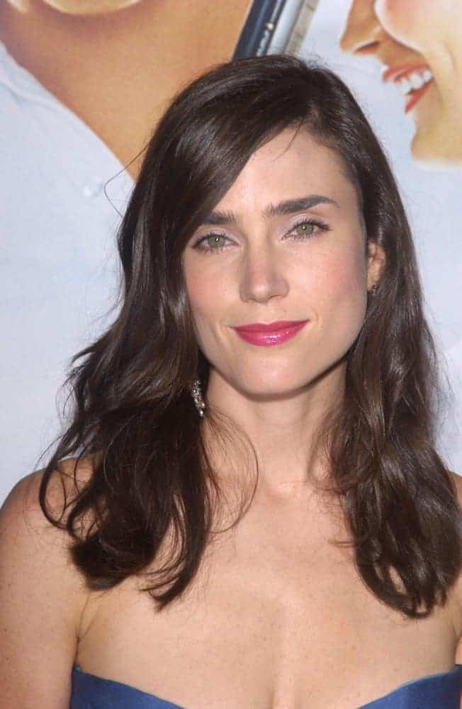 Actress Jennifer Connelly attended the world premiere, in Beverly Hills, of the new tennis romantic comedy Wimbledon on September 13, 2004. She paired her sexy strapless dress with a medium-length tousled and wavy dark layered hairstyle with side-swept bangs.