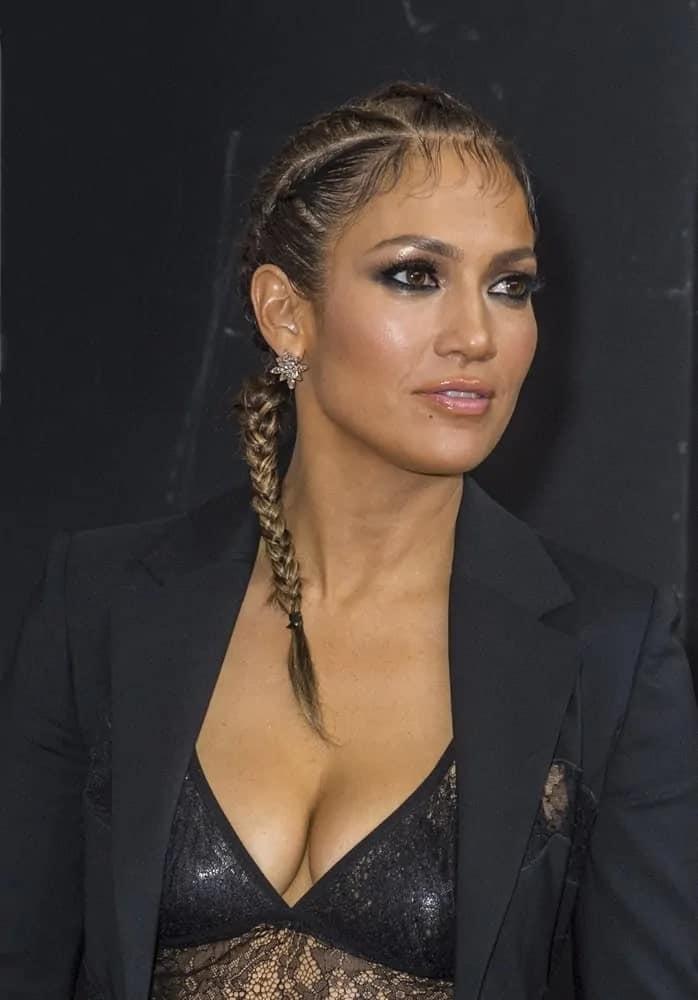 Jennifer Lopez wears her hair in boxer braids during the 2015 iHeartRadio Music Festival on September 19, 2015.