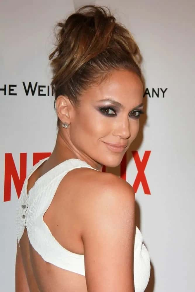 JLo's messy top knot statement hairstyle is perfection at the Weinstein Company / Netflix Golden Globes After Party on January 11, 2015.