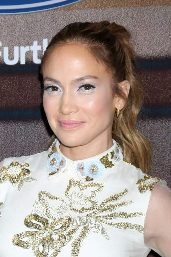 """Jennifer Lopez looked absolutely beautiful with her high wavy ponytail as she attends the """"American Idol Season 14"""" Finalist Party on March 11, 2015."""