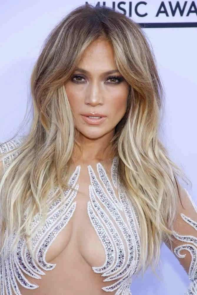 Jennifer Lopez adds some bounce on her loose center-part waves, giving her a fierce look at the 2015 Billboard Music Awards on May 17, 2015.