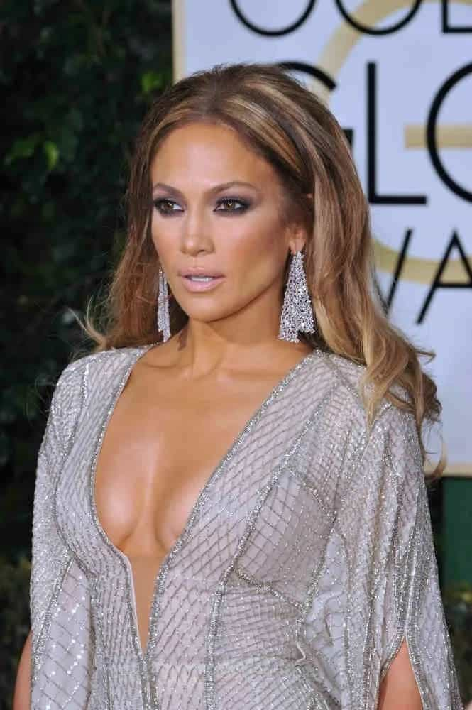 JLo's loose center-part curls hairstyle adds attitude to her dramatic looks at the 72nd Annual Golden Globe Awards on January 11, 2015.
