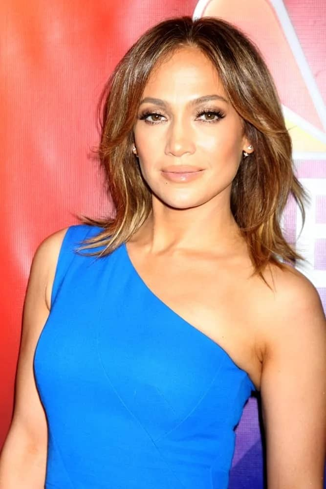 Jennifer Lopez cut her hair into a shoulder-length layered bob with a few fringed bangs that looks cute as she poses for the NBCUniversal TCA Press Day Winter 2016 event on January 13, 2016.