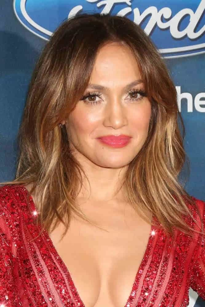 Jennifer Lopez blooms in a bob hairstyle with center-part bangs at the American Idol Farewell Season Finalist Party on February 25, 2016.