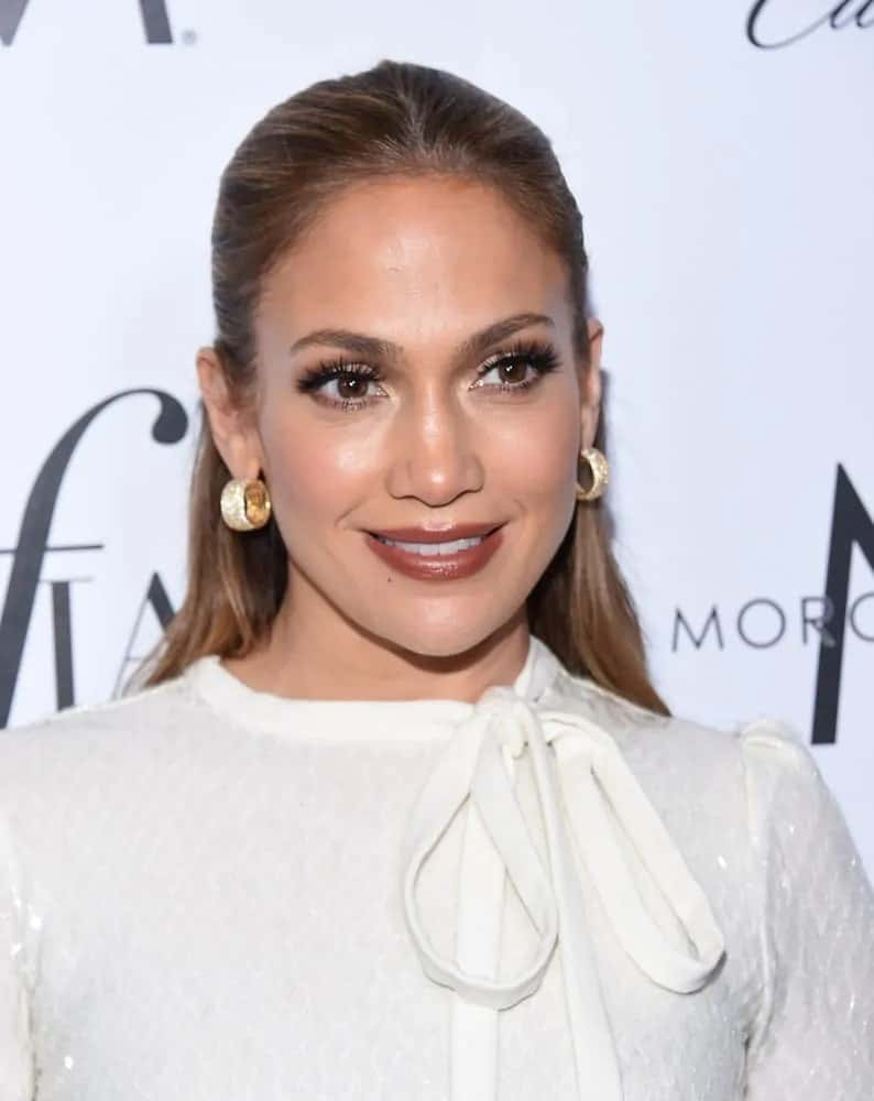 Jennifer Lopez wears a classy slicked back half up half down hairstyle at the 2nd Annual Fashion Los Angeles Awards on March 20, 2016.