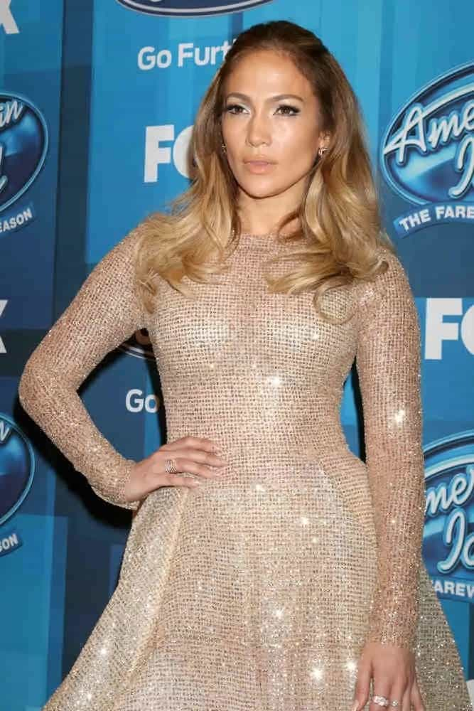 Jennifer Lopez's hairstyle is so feminine in a half-up ponytail as she attends the American Idol FINALE Arrivals on April 7, 2016.