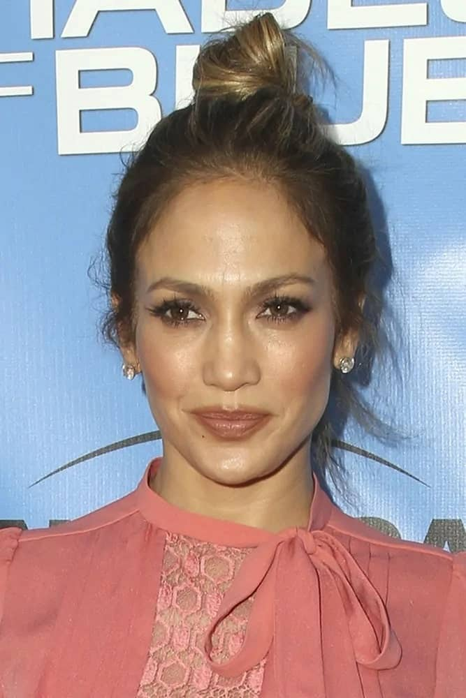 Jennifer Lopez rocks a messy but pretty top knot hairstyle at the Shades of Blue Television Academy Event on June 9, 2016.