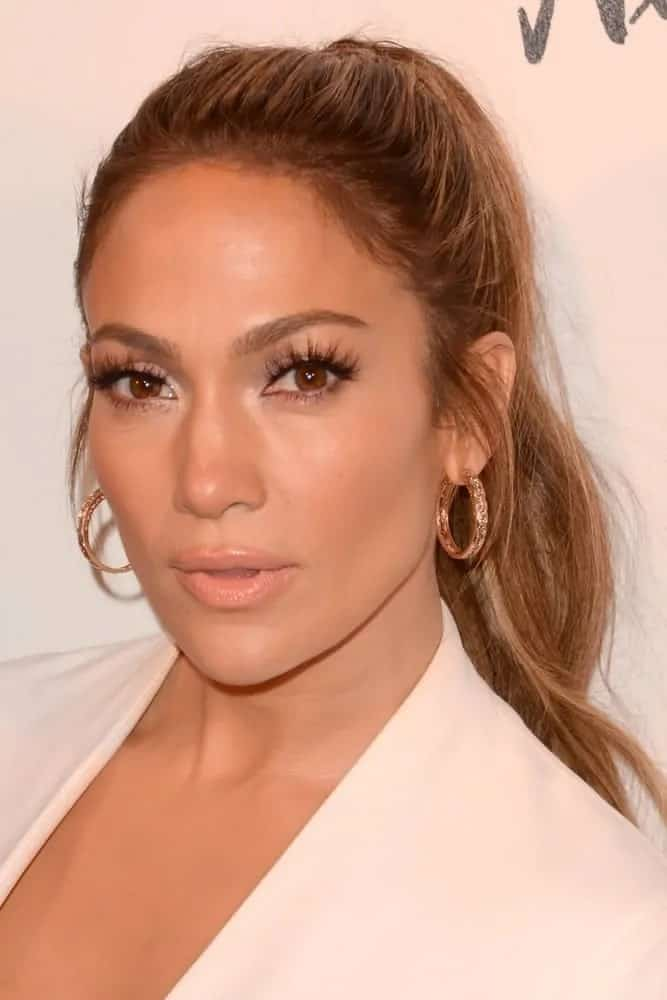 Jennifer Lopez pulled off a glamorous high ponytail for the Jennifer Lopez And Giuseppe Zanotti Celebrate Their New Shoe Collaboration on January 16, 2017.