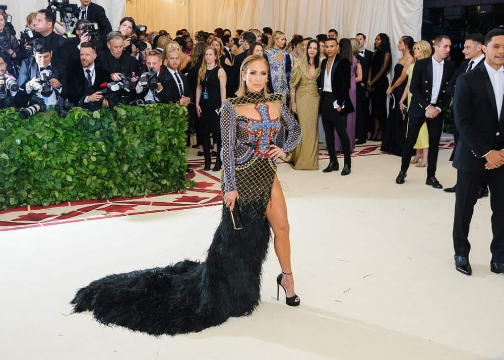Jennifer Lopez strikes a pose with her eye-catching dress and a slicked short hairstyle at the 2018 Metropolitan Museum of Art Costume Institute Benefit Gala last May 7, 2018.