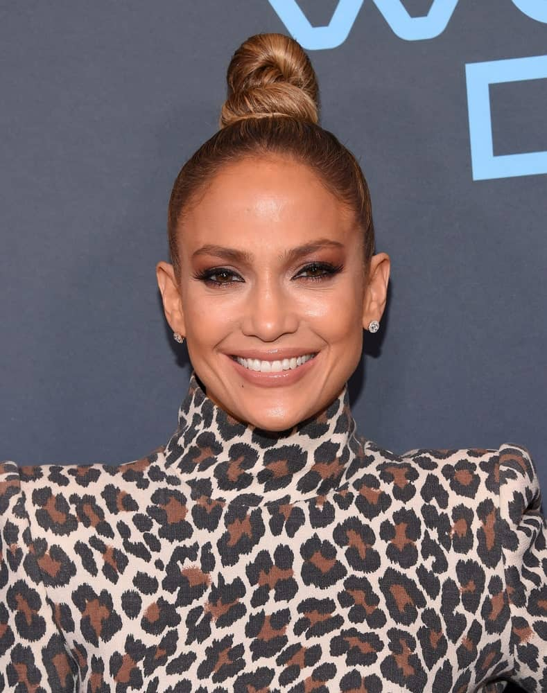 Jennifer Lopez wore a Jaguar print dress and a twisted top knot during the 'World Of Dance' FYC Event on May 1, 2018.