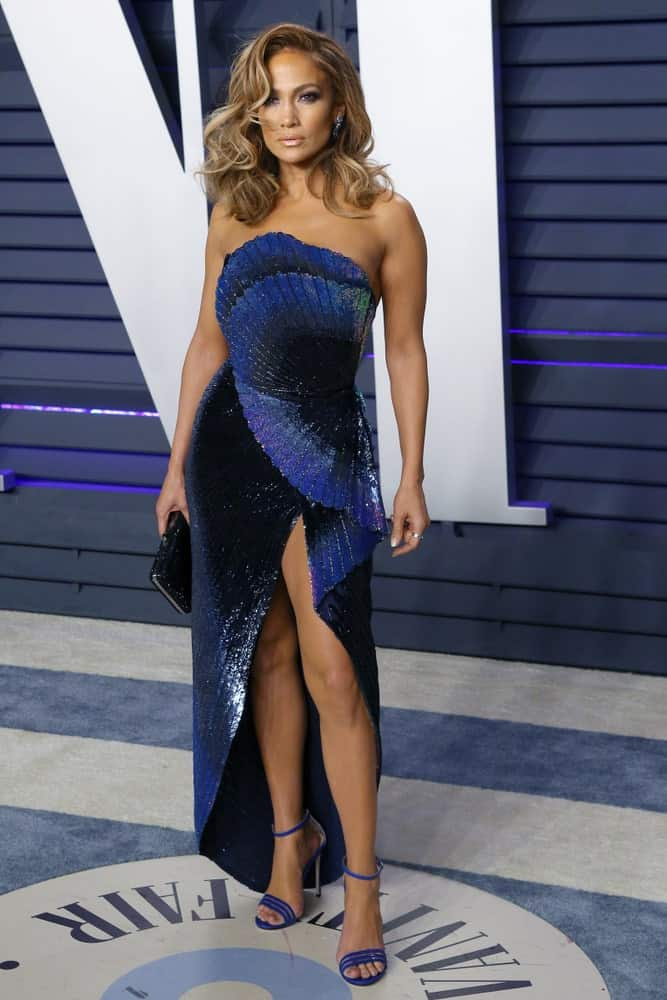 Jennifer Lopez looks fabulous in an edgy blue dress that she paired with side-parted waves at the 2019 Vanity Fair Oscar Party on February 24, 2019.