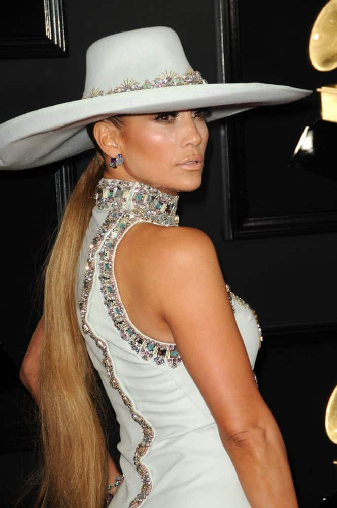 Jennifer Lopez topped her low ponytail with a statement hat at the 61st Grammy Awards on February 10, 2019.