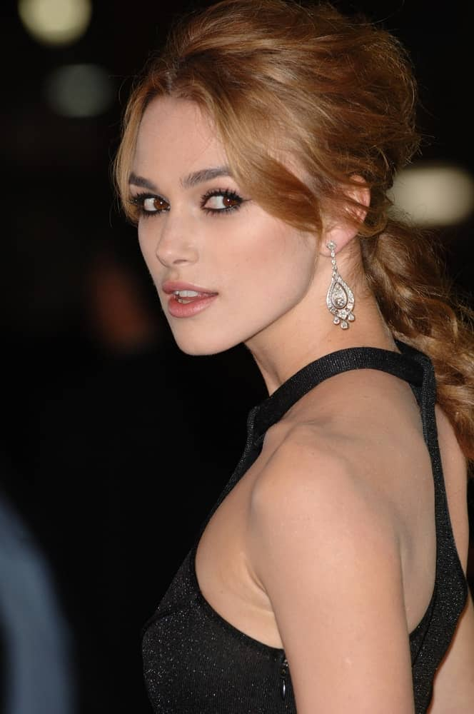 Keira Knightley attended the Los Angeles premiere of her new movie Domino on October 11, 2005, in Los Angeles, CA. She came in a sexy black dress that went well with her messy and tousled dark brown hair in a ponytail with side bangs.