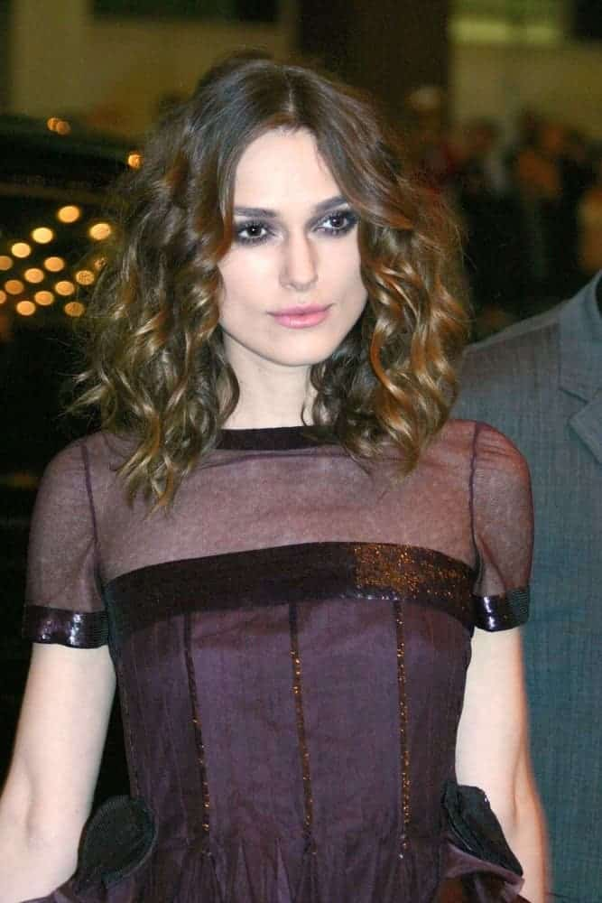 Keira Knightley wore a Chanel dress at the 32nd Annual Toronto International Film Festival in Elgin Theatre VISA Screening Room, Toronto on September 10, 2007. She paired her dress with a shoulder-length loose, tousled wavy dark brown hairstyle with layers.