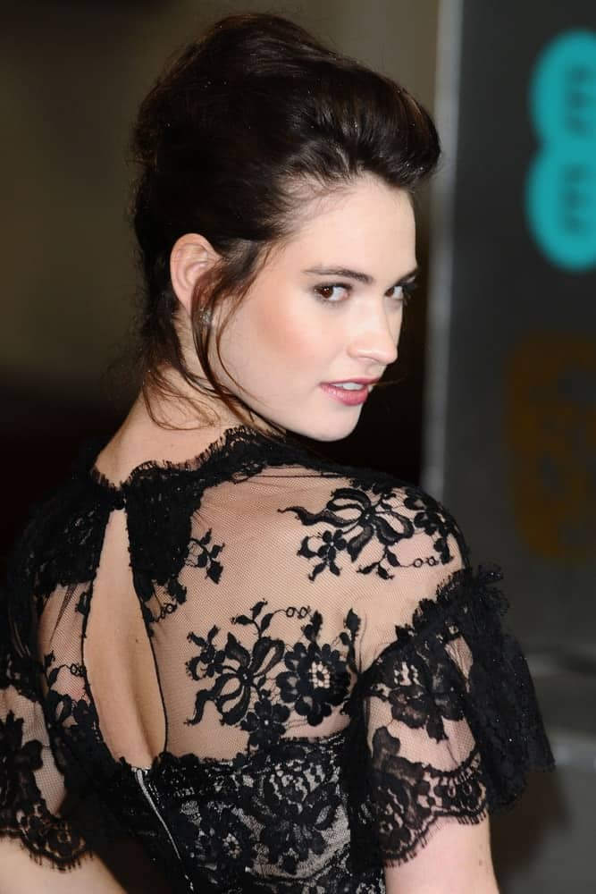 Lily James attended the EE BAFTA Film Awards 2013 at the Royal Opera House, Covent Garden, London on February 10, 2013. She paired her stunning black sheer dress with a raven high bun hairstyle that has loose tendrils.